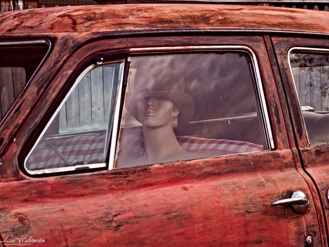 Mannikin in Old Red Studebaker