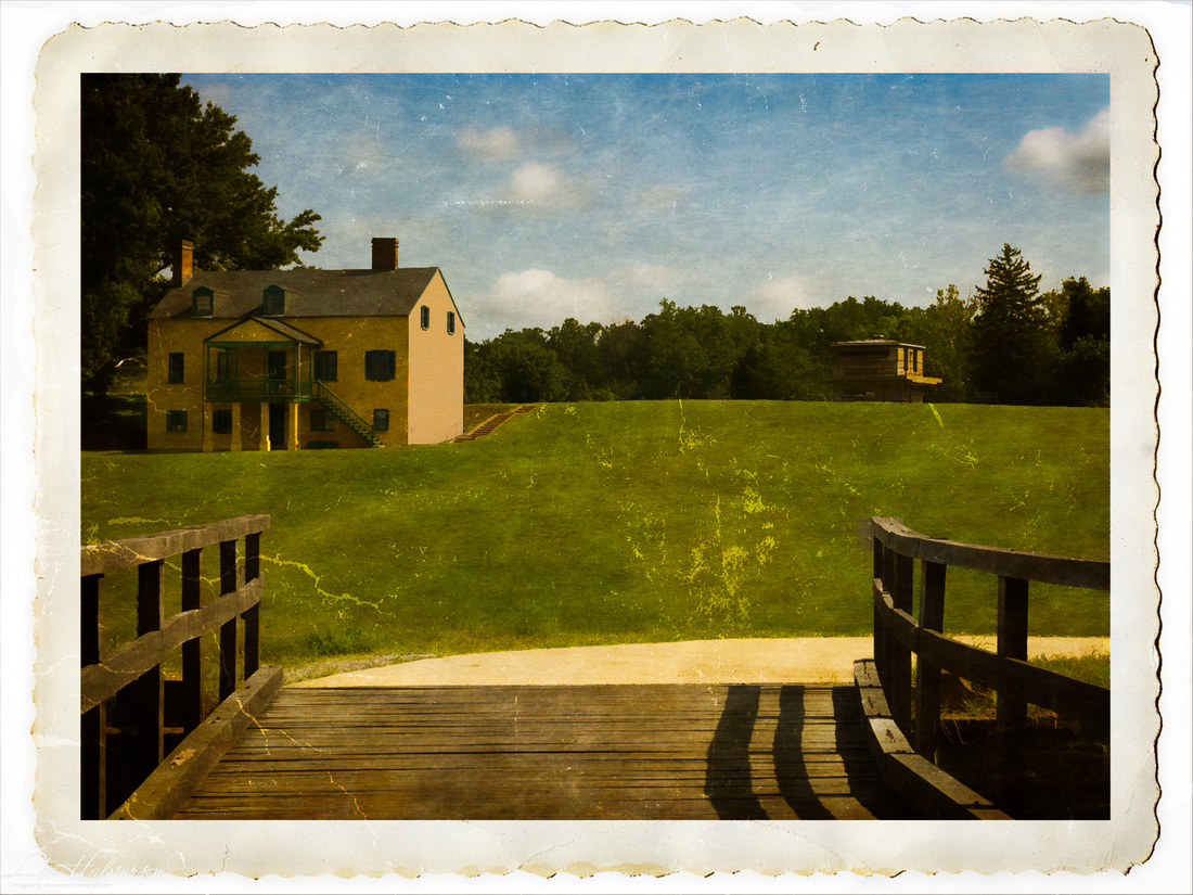 Stylized view from main gate looking back toward guard tower and visitors center