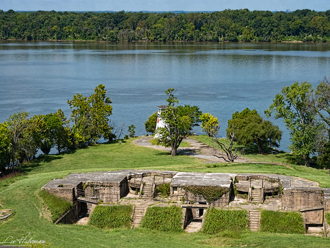 """View from Fort Washington looking down over an old battery, an old """"fog light"""" still in use today, and, across the Potomac at Virginia."""