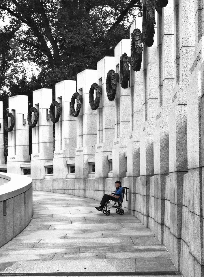 World War II Vet getting his picture taken at WWII Memorial