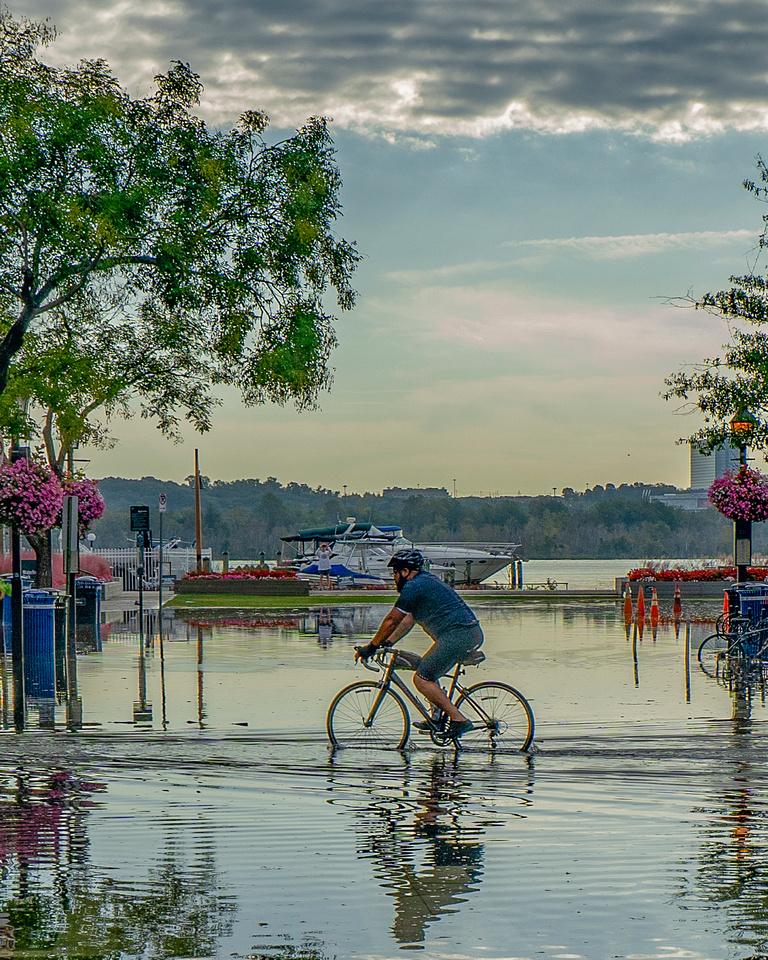 Biker going through flood on King Street