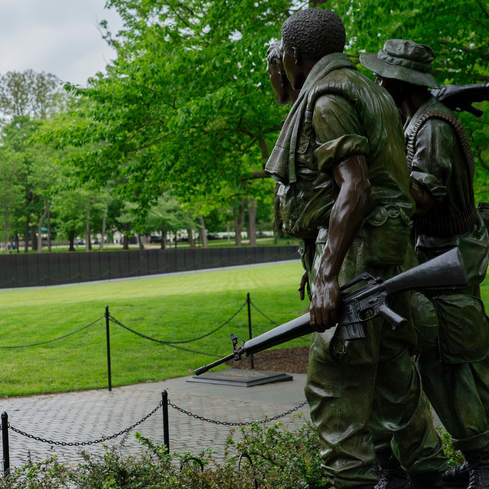 Soldier Sculptures Overlooking the Wall