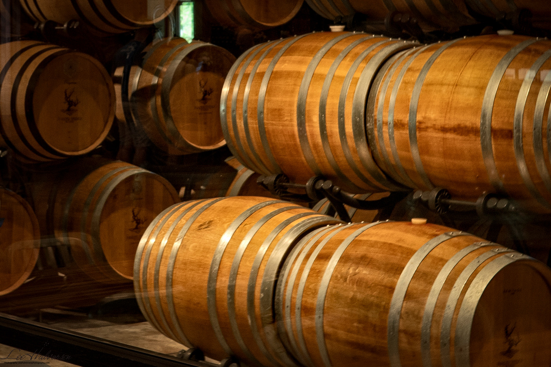 Barrels of wine aging next to Tasting Room at Paradise Springs Winery in Clifton, VA
