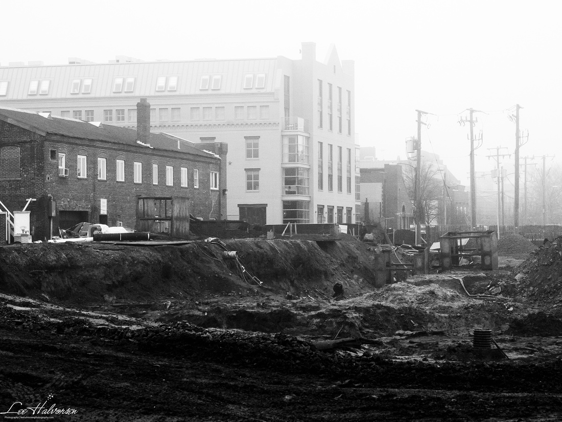 Excavation for new condos. Old shipyard building is the two story dark brick building. The taller one in the back is the new hotel.